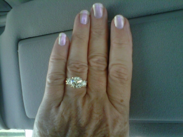 Phyllis' hand picture of her 3 stone anniversary ring brian gavin