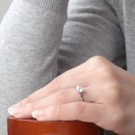 Cheyne's Hand Resting on the Brian Gavin Oval Wooden Ring Box