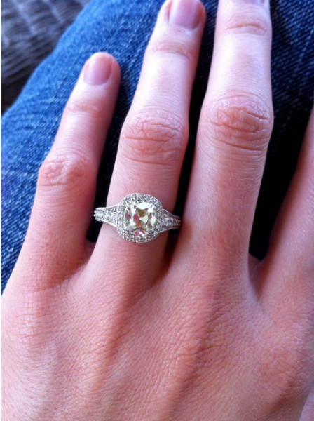 Engagement rings and wedding bands on hands