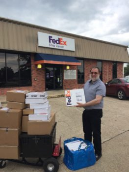 Brian Gavin drove more than five hours to arrive at a FedEx in College Station to deliver seven packages to expecting customers during Hurricane Harvey.