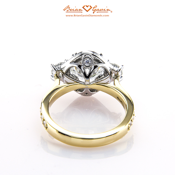 custom Venus Engagement Ring with an 18K Yellow Gold Shank and Platinum Gallery. The ring features a 2.064 H VVS1 center stone and two .245 H VS1 side stones.