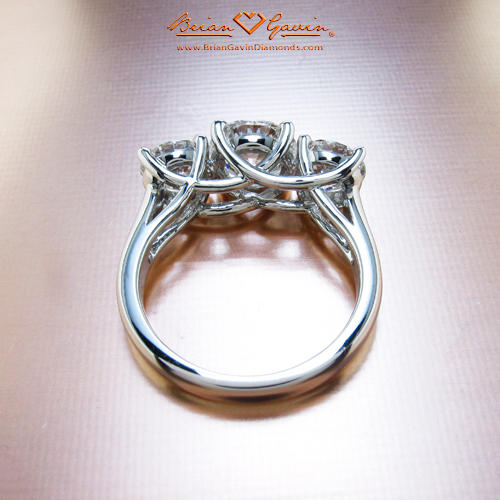 What ratio of center stone to accent diamonds is best for a three stone ring ?