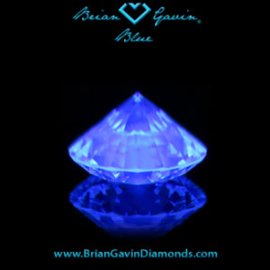 should i buy a j color diamond with strong blue fluorescence