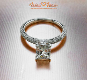 radiant cut diamond in pave engagement ring